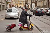 Travel photography:Man on a small scooter in Vienna , Austria