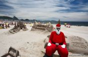 Travel photography:Santa Claus on a sand castle at Copacabana beach in Rio, Brazil