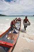 Travel photography:Fishermen landing their catch of bonito fish at Arraial-do-Cabo beach, Brazil