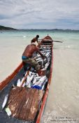 Travel photography:Fisherman landing their catch of bonito fish at Arraial-do-Cabo beach, Brazil