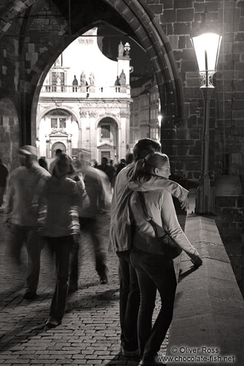 Couple on Charles bridge by night
