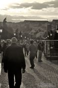 Travel photography:People on Charles Bridge (with a dark yellow tint), Czech Republic