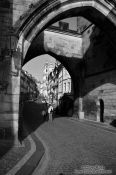 Travel photography:Leaving the Charles Bridge through the western gate, Czech Republic