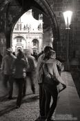 Travel photography:Couple on Charles bridge by night, Czech Republic