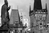 Travel photography:Skyline of the Lesser Quarter with statue viewed from Charles Bridge, Czech Republic