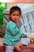 Travel photography:Small girl at Wat Phnom in Phnom Penh, Cambodia