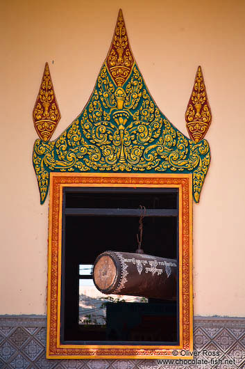 Temple window with large drumm near Odonk (Udong)