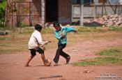 Travel photography:Kids playing football at a temple near Odonk (Udong) , Cambodia