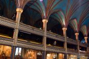 Travel photography:Wooden architecture of the Basilica de Notre Dame cathedral in Montreal, Canada