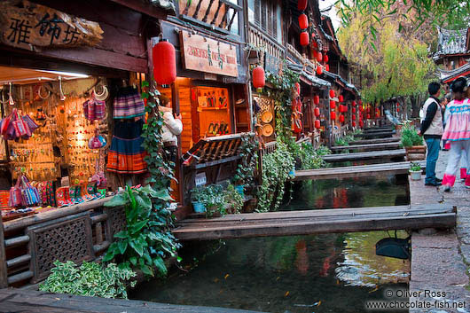 Channel with wooden bridges in Lijiang´s old town