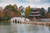 Travel photography:Lijiang Black Dragon Pool with pagoda and bridge , China