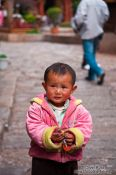 Travel photography:Small child in Lijiang street, China