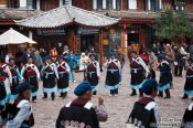 Travel photography:Group of Naxi women performing a traditional dance in Lijiang, China