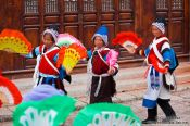 Travel photography:Naxi women performing a traditional dance in Lijiang, China