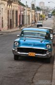 Travel photography:Cienfuegos street with classic car, Cuba