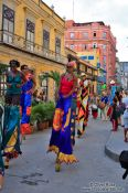 Travel photography:Group of performers on stilts, Cuba