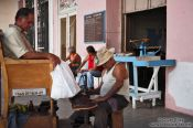 Travel photography:Polishing shoes in Sancti-Spiritus, Cuba