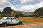 Travel photography:Car parked in the Viñales landscape, Cuba