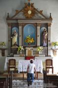 Travel photography:Man praying inside the Viñales church, Cuba