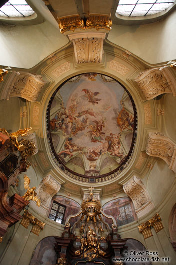 Painted ceiling of a chapel in Prague`s St. Nicolas church