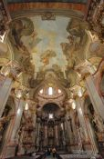 Travel photography:Main ship of Prague`s St. Nicolas church, Czech Republic