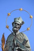 Travel photography:Bronze sculpture of St John of Nepomuk on Charles bridge, Czech Republic