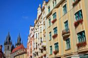 Travel photography:Houses in Prague`s Old Town with Tyn church in the background, Czech Republic