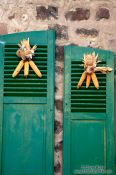 Travel photography:Sweet corn decoration on two window shutters, France