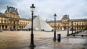 Travel photography:The Louvre museum in Paris with glass pyramid, France