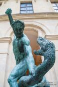 Travel photography:Sculpture of Hercules and the serpent at the Louvre museum in Paris, France