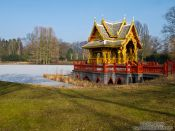 Travel photography:Frozen lake with Thai pavilion at the Tierpark Hagenbeck zoo in Hamburg, Germany