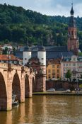 Travel photography:View of Heidelberg's old bridge across the Neckar River with the Holy Ghost church and old city gate, Germany