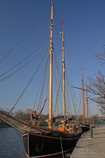 Old sailing boats on the Trave river in Lübeck