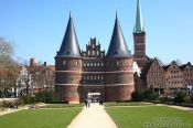 Travel photography:The famous Holstentor (city gate) in Lübeck with part of the city skyline, Germany