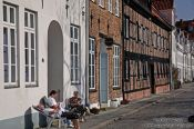 Travel photography:People enjoying the good weather outside their house in Lübeck, Germany
