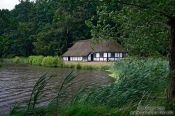 Travel photography:18th century half-timbered house and lake, Germany