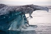 Travel photography:Detail of an iceberg washed up at the beach near Jökulsárlón, Iceland
