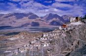 Travel photography:Diskit Gompa (buddhist monastery) with Chosling School in the background, India