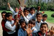 Travel photography:Srinagar kids competing for the best spot in front of the camera, India