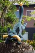Travel photography:Fox sculpture at the entrance to Kyoto`s Inari shrine, Japan