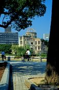 Travel photography:Cyclist in front of The Atomic Bomb Dome in Hiroshima, Japan