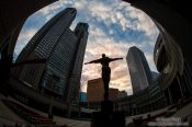Travel photography:Statue with Tokyo Metropolitan Government Building in Shinjuku, Japan