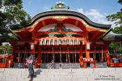 Travel photography:Girl in Kimono ascending the stairs to Kyoto´s Inari shrine, Japan