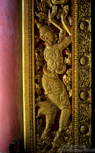 A window shutter inside the Haw Pha Bang temple in Luang Prabang