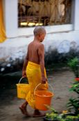 Travel photography:Young monk novice working in Luang Prabang, Laos