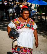 Travel photography:Woman in Mayan dress in Chichen Itza, Mexico