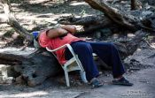 Travel photography:Chichen Itza man sleeping, Mexico