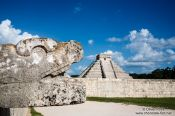 Travel photography:Snake head with Central pyramid at the Chichen Itza archeological site, Mexico