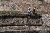 Travel photography:People sitting at the base of the sub pyramid at the Teotihuacan archeological site, Mexico
