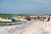 Travel photography:Fishing boats return to Celestun beach, Mexico